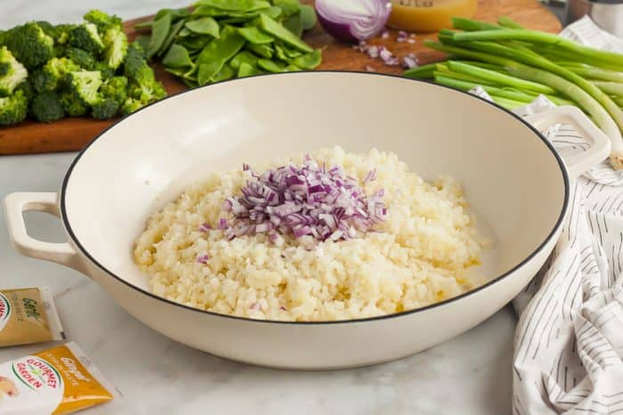 cauliflower rice and red onion sitting in a dish