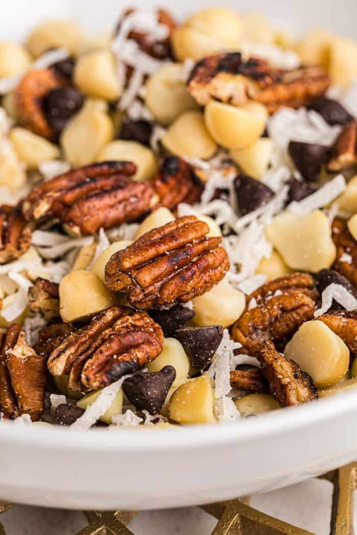 closeup view of low carb trail mix in a large white bowl