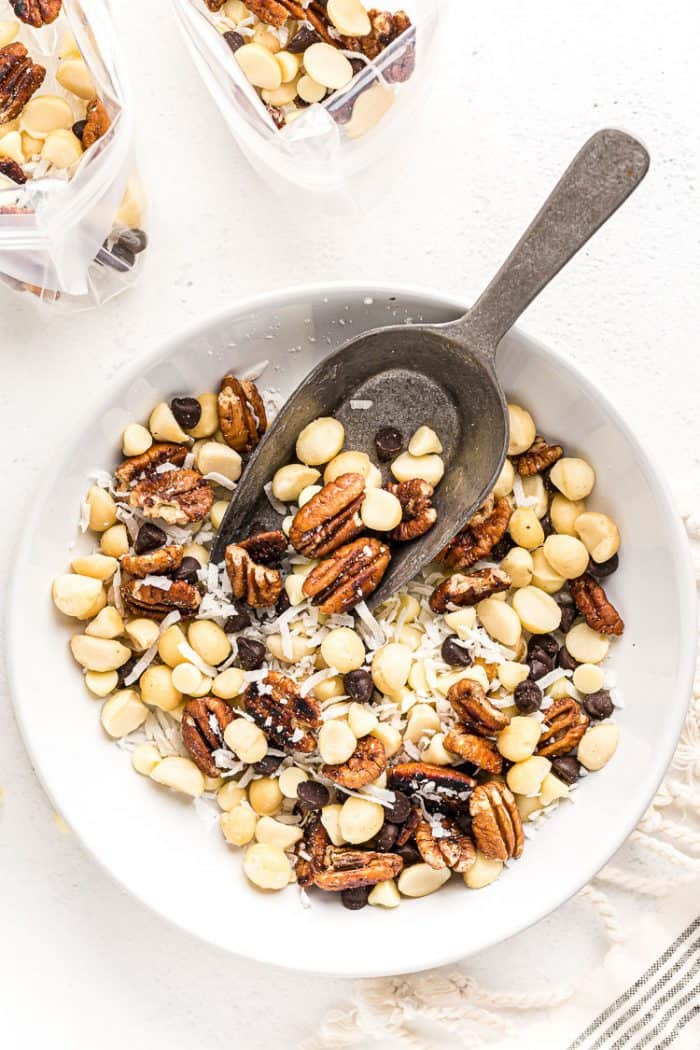 overhead view of keto trail mix in a white bowl with a spoon