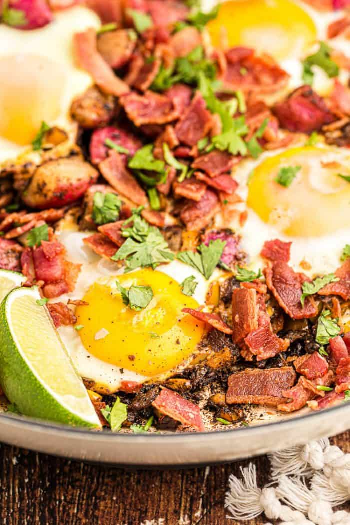 closeup of keto breakfast skillet with eggs and bacon