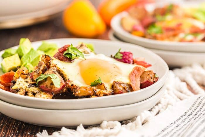 side view of cooked keto breakfast skillet in white plates