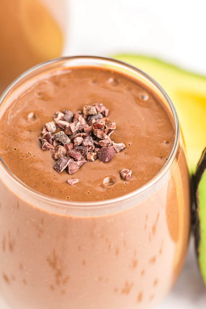 closeup of keto chocolate smoothie with cacao nibs sprinkled on top