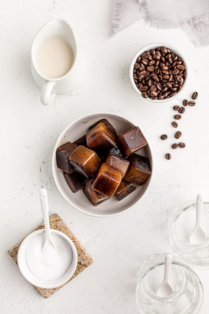 overhead view of bowl of keto iced coffee cubes next to milk