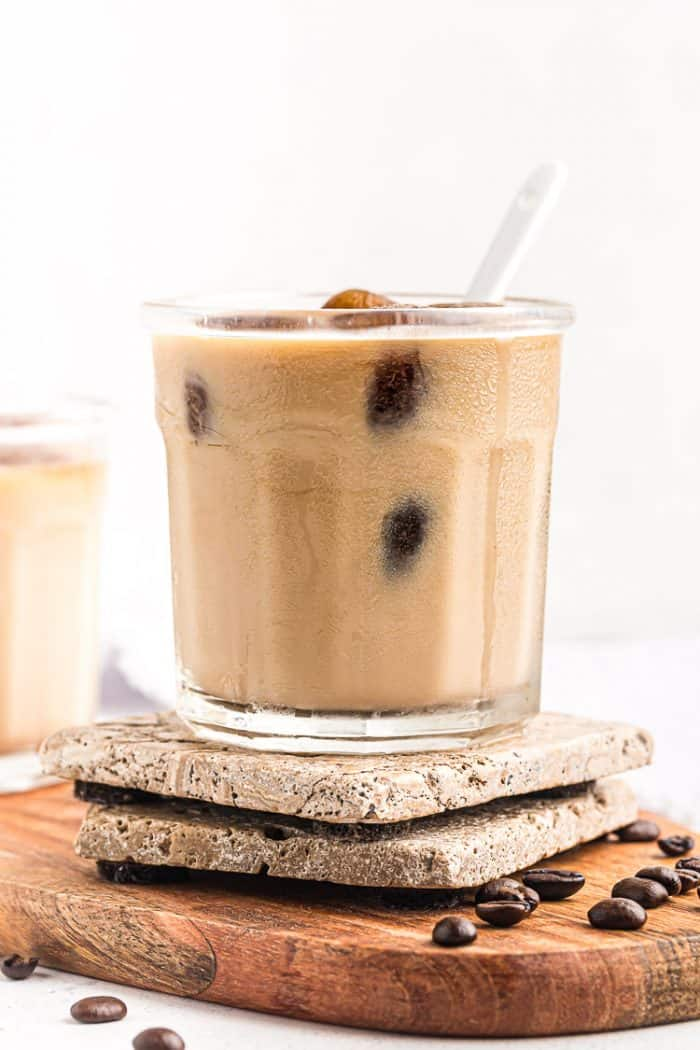 side view of keto easy iced coffee in a short glass with a spoon sticking out