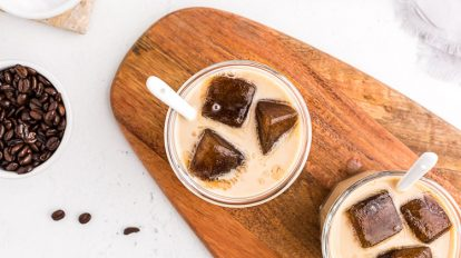 overhead view of keto easy iced coffee after milk has been added to glasses