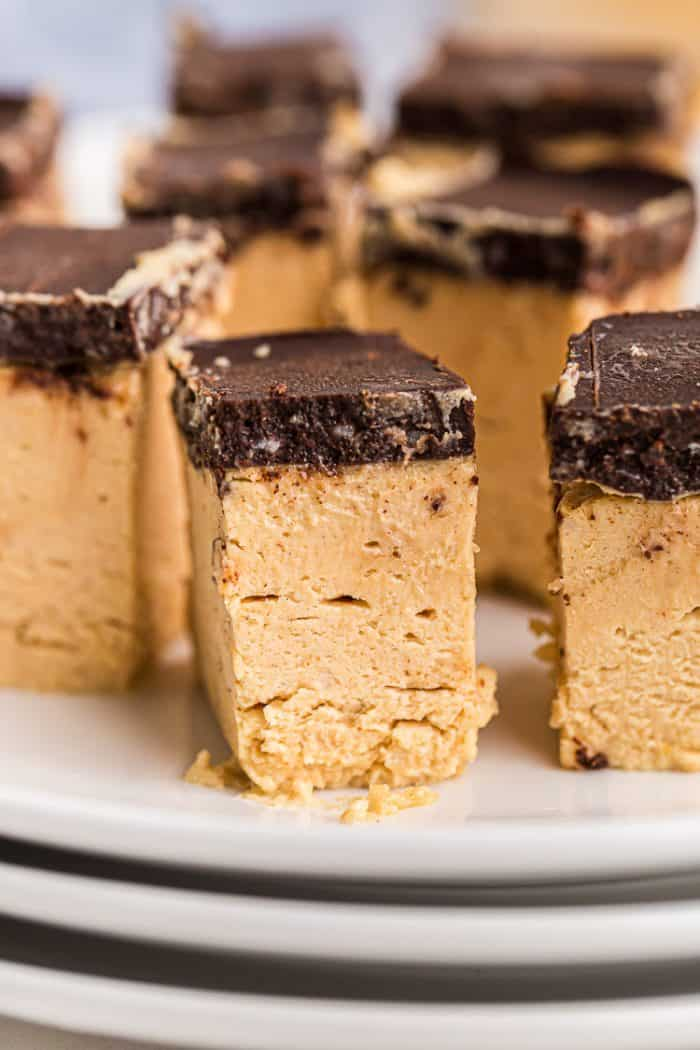 closeup of a keto peanut butter dessert piece with a chocolate topping