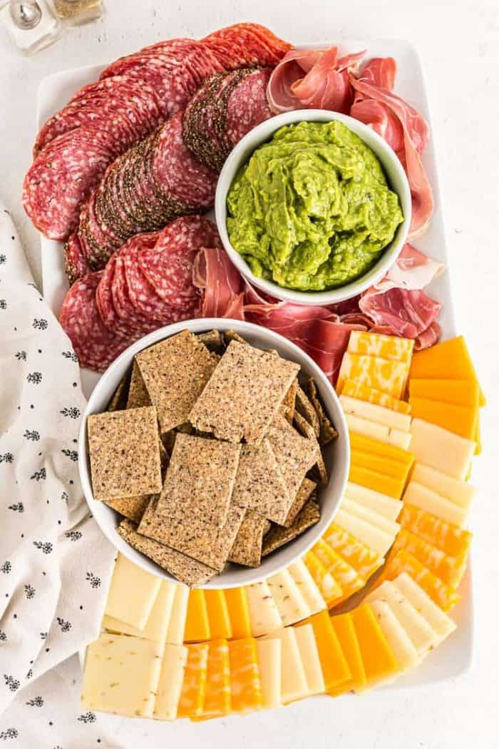 overhead view of full party spread with keto crackers in a bowl