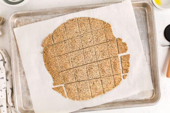 dough cut into pieces on parchment paper for almond flour crackers