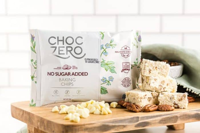 bag of choczero white chocolate chips next to keto fudge on a table
