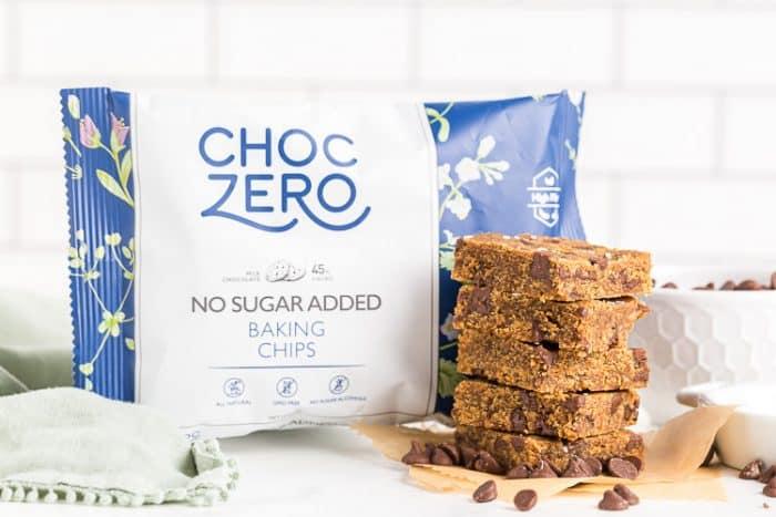 bag of choczero milk chocolate chips next to keto cookie bars