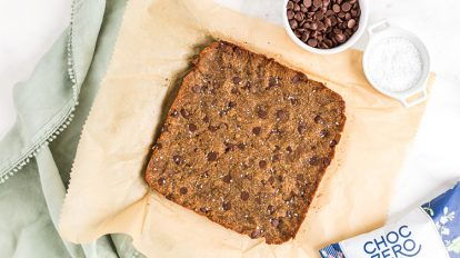 overhead view of fully cooked low carb cookie bar on top of parchment paper