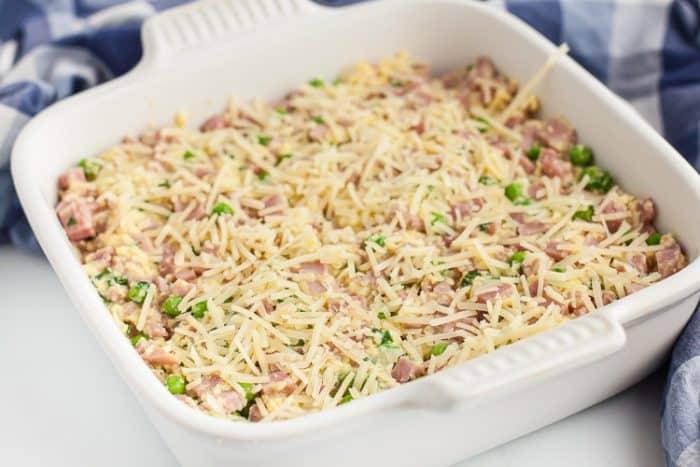 white casserole dish containing uncooked keto ham casserole