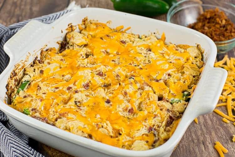 side view of jalapeño popper chicken casserole in white casserole dish for keto diet