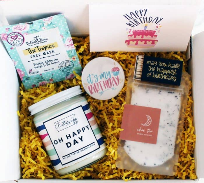 happy birthday gift box with a candle face scrub and bath items
