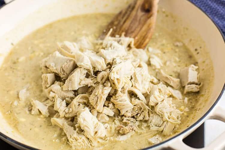 wooden spoon in skillet next to keto chicken mixture