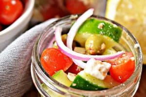 small mason jar containing keto greek salad in a jar