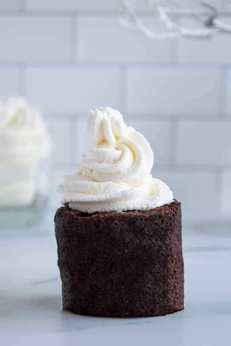 chocolate mug cake topped with keto whipped cream