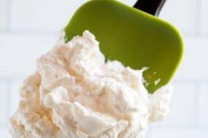green spatula containing keto whipped cream