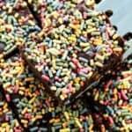 closeup of keto brownies with sprinkles on top in a pan