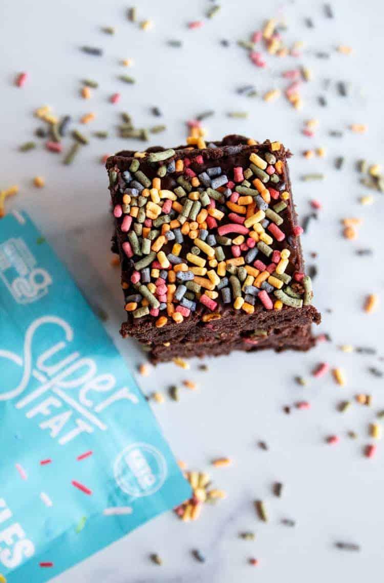 overhead view of keto brownies with sprinkles next to superfat keto sprinkles bag