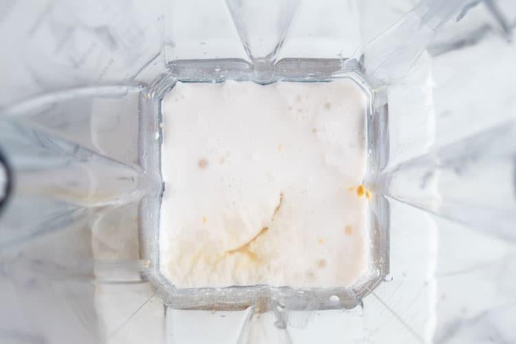 overhead view of keto peanut butter smoothie ingredients in blender
